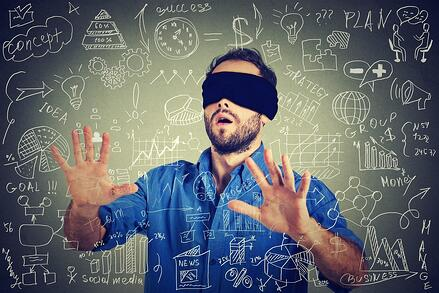 blindfolded man with blackboard